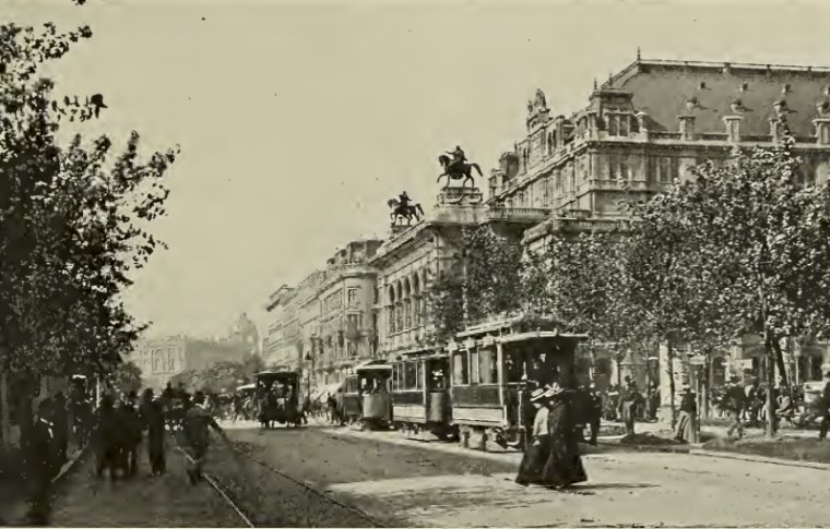 A black and white photo of Vienna with trams.