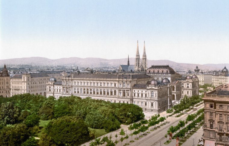 The view of a palace with church spires behind.