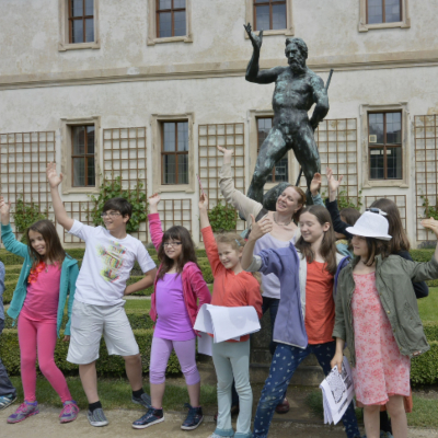 a group of kids on a walking tour in Prague
