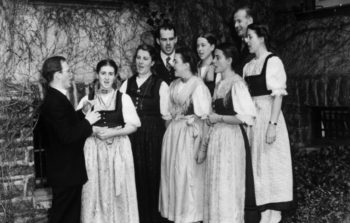 black and white photo of family singing