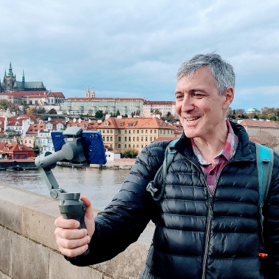 a man doing a live stream on the Charles bridge in Prague
