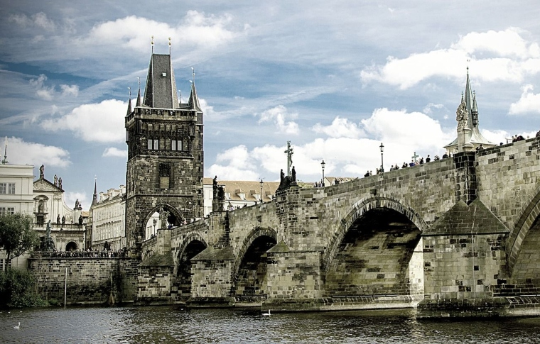 a closer view of Charles' bridge on a cloudy day
