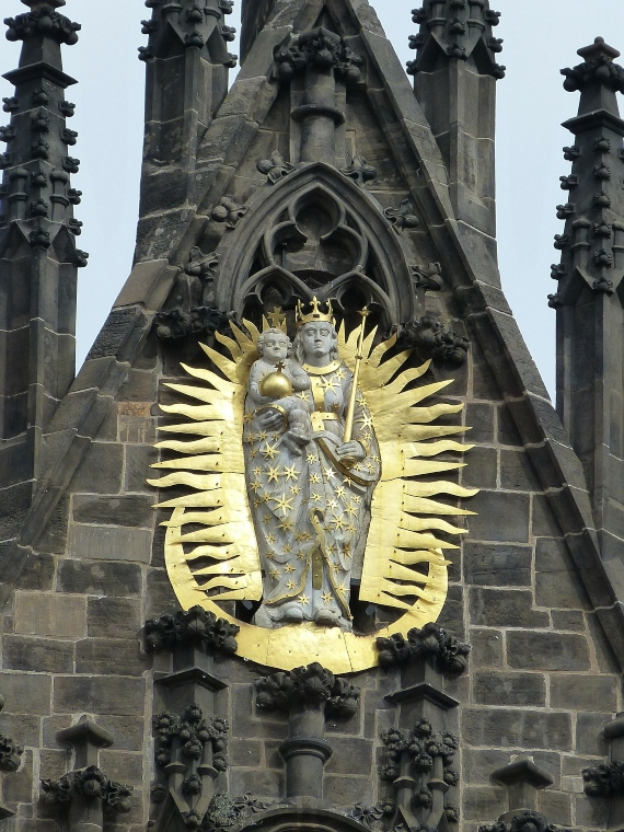 gold ornament on the facade of a gothic church